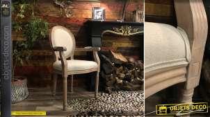 Fauteuil médaillon en bois sculpté finition blanchi et assise épaisse en lin beige, style classique, 96cm