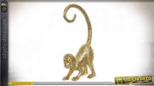 Représentation d'un singe en résine finition dorée, ambiance tropicale chic, 33cm