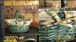 Panier en éclisse de noisetier teinté vert olive, anses mobiles et doublure en coton motifs olives vertes