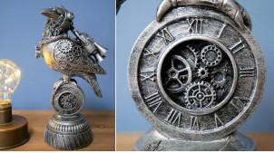 Statuette d'oiseau en version Steampunk, en résine effet metal avec engrenages et roues, détails finition laiton doré, 24 cm