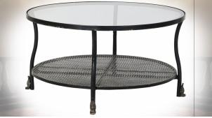 Table basse en métal finition noire et reflets dorés, plateau en verre transparent ambiance industrielle, Ø85cm