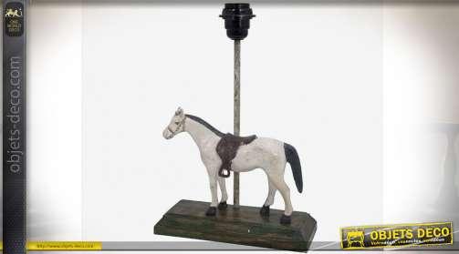 Pied de lampe en bois sculpté sur le thème du cheval et de l'équitation