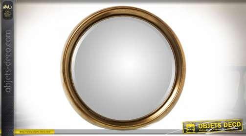 Miroir circulaire de 80 cm avec encadrement en saillie finition dorée vieillie et glace biseautée