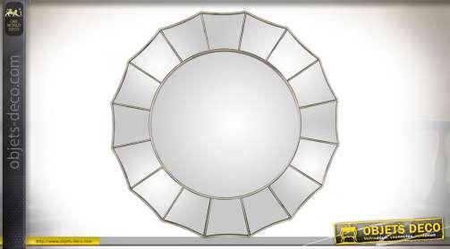 Miroir rond en verre et résine finition effet métal argenté vieilli.