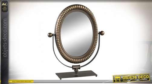 Miroir ovale à poser sur support en métal avec encadrement en laiton doré