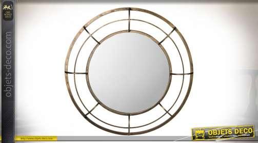 Miroir rond de style industriel avec encadrement en forme de grille en laiton doré ancien