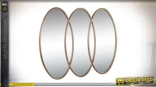 Miroir mural décoratif design composé de 3 ovales entremêlés en métal finition dorée