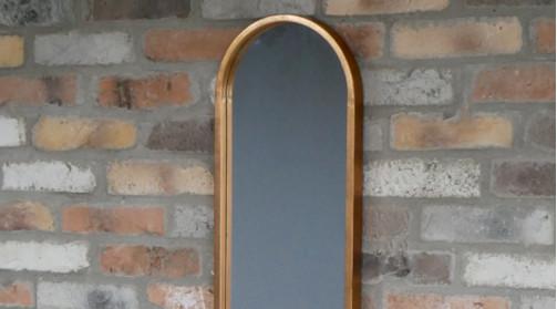 Miroir de 130cm de haut avec extrémités arrondies, encadrement en métal effet cuivre ancien