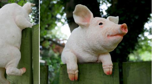 Représentation d'un petit cochon en résine à positionner sur une barrière ou cloture