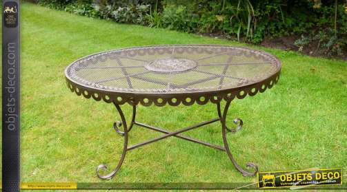 Table de jardin de forme ovale en fer forgé et métal finition marron antique