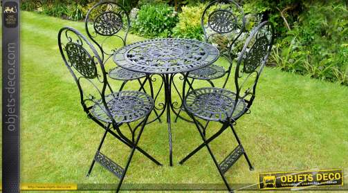 Salon de jardin en fer forgé coloris noirr antique comprenant une table ronde et quatre chaises assorties