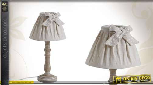 Lampe de chevet avec pied en bois tourné et abat-jour tissu avec noeud.