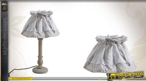Lampe de chevet avec pied en bois tourné et abat-jour conique en tissu orné d'un noeud, coloris grège.