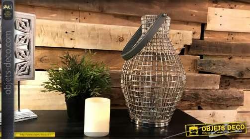 Bougeoir en forme de vase, en métal coloris argent avec photophore et anse similicuir.