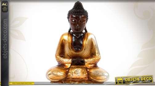 Statuette en bois représentant Buddha en méditation, finition dorée.