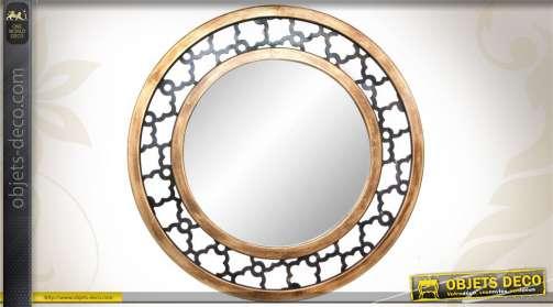 Miroir mural de forme ronde, en verre et avec encadrement en bois, de style ethnique.