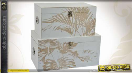 Série de 2 coffres de rangement coloris blanc et orné de motifs végétaux, réalisés en bois.