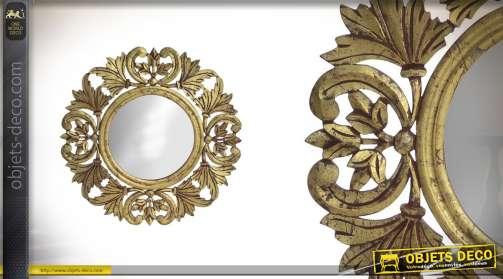 Miroir en bois sculpté motifs floraux finitions dorées baroques 59cm de diam