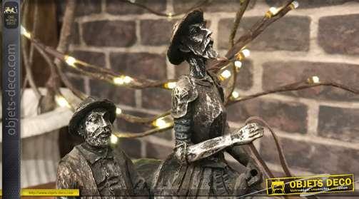 Statuette en résine imitation bronze cuivré vieilli, représentant, à cheval, les deux personnages principaux du roman de Miguel de Cervantes, L?Ingéni