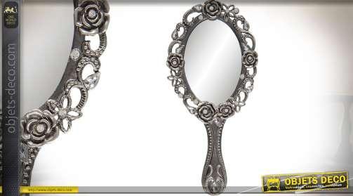 Miroir en métal argenté, de style rétro et romantique, forme ovale avec motifs floraux en relief