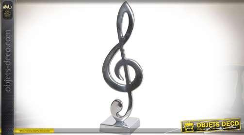Statuette en aluminium argenté brillant représentation un trophée en forme de clé de sol