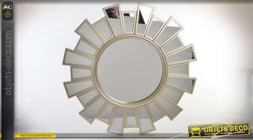 Miroir mural rond avec encadrement en rayonnement multifacettes finition dorée