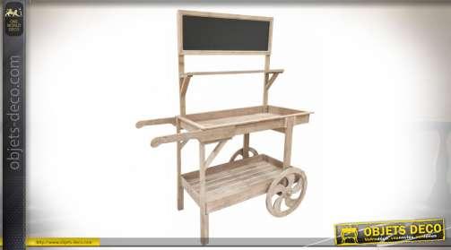 Présentoir commercial en bois vieilli, prenant la forme d'un ancien chariot à bras, avec trois plateaux de présentation
