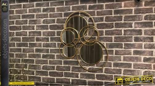 Miroir moderne en métal finition ancienne, vieux doré, formes de cercles abstrait