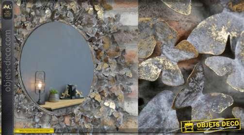 Miroir rond en métal avec encadrement chargé de papillons métalliques vieux bronze et doré