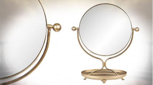 Miroir à poser en métal, forme ronde et finition dorée, ambiance vintage