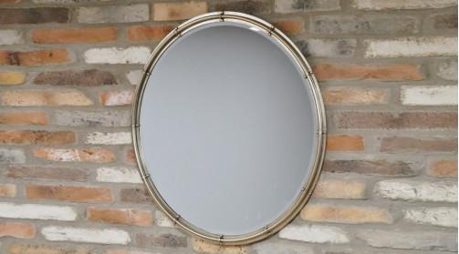 Miroir circulaire en métal de style industriel, finition argenté effet brossé, glace biseautée