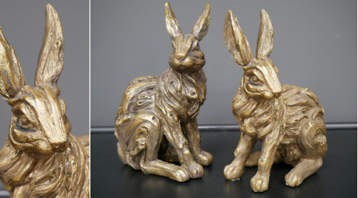 Représentation de deux lapins en résine finition doré ancien,
