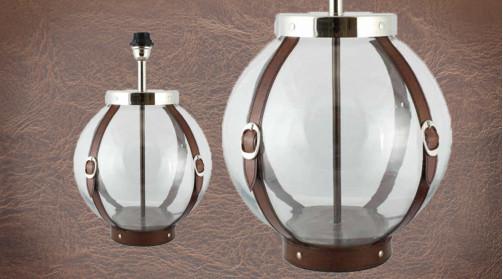 Pied de lampe en forme de globe en verre avec ceintures déco en cuir, ambiance chic